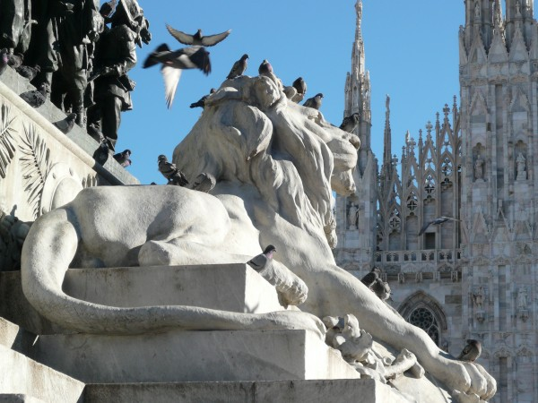 Lion under the statue of Victor Emmanuelle II in Milan