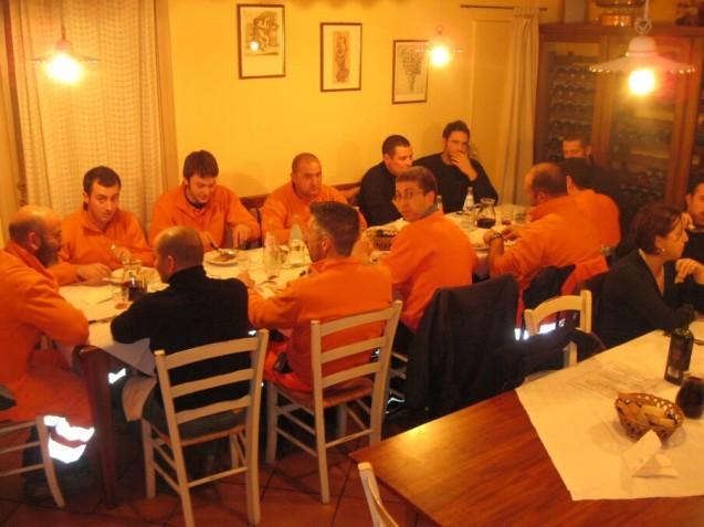 Orange-suited workers feast